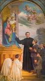 TURIN, ITÁLIA - 15 DE MARÇO DE 2017: A pintura de Don Bosco e de Mary Help dos cristãos na basílica Maria Ausiliatrice da igreja Fotografia de Stock Royalty Free