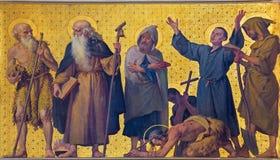 TURIN, ITALIEN - 15. MÄRZ 2017: Das symbolische Fresko von heiligen Mönchen und von eremits in der Kirche Chiesa di San Dalmazzo Stockfotografie