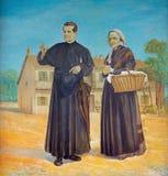 TURIN ITALIEN - MARS 15, 2017: Målningen av helgonet Don Bosco med hans moder Margherita i den kyrkliga basilikan Maria Ausiliatr Royaltyfri Fotografi