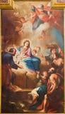 TURIN ITALIEN - MARS 13, 2017: Målningen av Kristi födelse i kyrkliga Chiesa di Santa Teresia av Sebastiano Conca 1730 Arkivbilder