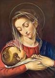 TURIN ITALIEN - MARS 15, 2017: Målningen av Madonna med barnet i kyrkliga Chiesa di San Dalmazzo av den okända konstnären Arkivbild