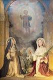 TURIN ITALIEN - MARS 14, 2017: Målningen av Saint Lucia och st-ros av Lima i kyrkliga Chiesa di San Domenico av Enrico Reffo Royaltyfria Bilder