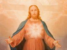 TURIN ITALIEN - MARS 14, 2017: Målningen av sakral hjärta av Jesus i kyrkliga Chiesa di Santa Maria della Consolazione Arkivbilder
