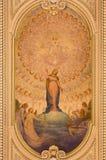TURIN ITALIEN: Takfreskomålningen av den obefläckade befruktningen och hjärta av Jesus i sidokapellet av kyrkliga Chiesa di Santo royaltyfri bild