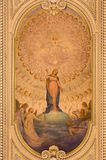 TURIN, ITALY: The ceiling fresco of Immaculate Conception and Heart of Jesus in side chapel of church Chiesa di Santo Tomaso royalty free stock image
