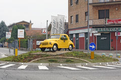 Turin, Italy - Fiat Topolino 500 c Oldtimer. TURIN, ITALY - OCTOBER 2: Model of Fiat Topolino 500 C oldtimer from 1936-57 is palced at one roundabout in Borgaro Royalty Free Stock Photography