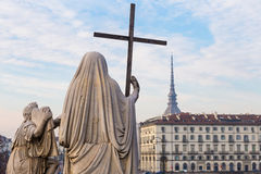 Turin, Italy - January 2016: Religion Statue. Religion Statue with cross - located in front of Gran Madre Church, Turin Royalty Free Stock Photos