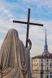 Turin, Italy - January 2016: Religion Statue. Religion Statue with cross - located in front of Gran Madre Church, Turin Royalty Free Stock Image