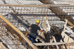 Turin, Italy 1  June 2013 : Carpenter at work in construction site preparing Stock Images