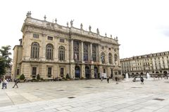 Turin, Italy- June 12, 2018: Piazza Castello, central baroque square in Turin, Italy. Tourists visiting Piazza Castello, the centr. Al baroque square royalty free stock photo