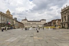 Turin, Italy- June 12, 2018: Piazza Castello, central baroque square in Turin, Italy. Tourists visiting Piazza Castello, the centr. Al baroque square royalty free stock photography