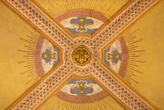 TURIN, ITALY - MARCH 15, 2017: The detail of symbolic fresco on the ceiling in church Basilica Maria Ausiliatrice. By unknown artist of 19. cent Royalty Free Stock Photo