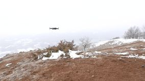 Turin, Italy - March 4, 2018: Dji Mavic Air Drone landing in the mountains, cloud weather, snow. Turin, Italy - March 4, 2018: Dji Mavic Air Drone landing in stock video