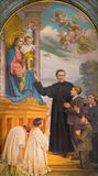 TURIN, ITALY - MARCH 15, 2017: The painting of Don Bosco and Mary Help of Christians in church Basilica Maria Ausiliatrice. By Paolo Giovanni Crida 1941 Royalty Free Stock Photography