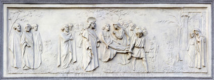 TURIN, ITALY - MARCH 15, 2017: The relief of Resurrection of the Widow`s Son at Nain on the facade of church Basilica Maria Ausili Stock Photos