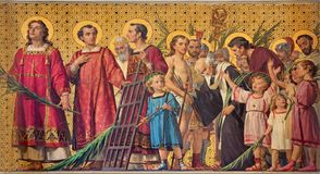 TURIN, ITALY - MARCH 15, 2017: The symbolic fresco of holy amartyrs with the in church Chiesa di San Dalmazzo. By Enrico Reffo 1831-1917 Royalty Free Stock Image