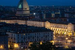 Cityscape of Torino Turin, Italy at night with details of large square, streets and city lights. The Mole Antonelliana in the ba stock photo