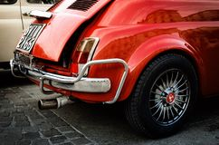 Fiat 500 Abarth classic car in Turin. TURIN, ITALY - SEPTEMBER 24, 2017 - Old red Fiat 500 Abarth during a classic car rally in Vittorio Veneto Square, Turin Royalty Free Stock Images