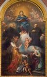 Turin - målning av `-Vergine tra I ss Biagio e Liduvina ` i kyrkliga Chiesa di San Francesco av Isabela Maria dal Pozzo 1666 Fotografering för Bildbyråer