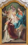 Turin - målningen av Madonna med St Ignace av den Loyola grundaren av jesuit i kyrkliga Chiesa di San Francesco D Asissi Royaltyfri Bild