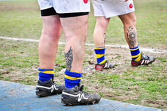 Second Derby della Mole between Cus Torino and Rugby Torino. TURIN - MARCH 9: Tattoos on the legs of unidentified players of the Rugby Torino team during the stock photo