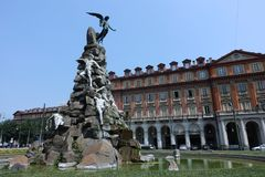 Turin Monument to the Frejus tunnel in square Statuto. Turin Piedmont Italy At the center of the square Statuto there is an impressive monument, dedicated to the royalty free stock photos