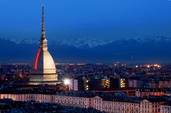 Turin by night. Mole Antonelliana (Turin symbol) from Monte dei Cappuccini, at dusk, with Christmas artistic lights on Mole Antonelliana (National Cinema Museum stock photography
