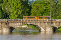 Turin, old orange tram on a bridge Royalty Free Stock Images