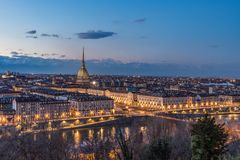 Turin skyline at dusk, Torino, Italy, panorama cityscape with the Mole Antonelliana over the city. Scenic colorful light and drama. Tic sky royalty free stock photo