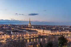 Turin skyline at dusk, Torino, Italy, panorama cityscape with the Mole Antonelliana over the city. Scenic colorful light and drama. Tic sky Royalty Free Stock Image