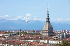 Turin skyline view, Mole Antonelliana tower and hot air balloon in a sunny day in Italy. Turin skyline view, Mole Antonelliana tower and hot air balloon in a stock photography