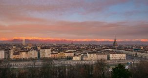 Turin Time lapse Italy, Torino skyline with the Mole Antonelliana towering over the buildings, sunrise with colorful sky glowing A stock footage
