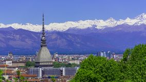 Turin, Torino, aerial timelapse skyline panorama with Mole Antonelliana, Monte dei Cappuccini and the Alps in the background. Turin Torino aerial timelapse royalty free stock photography