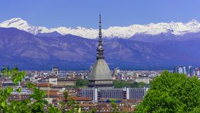 Turin, Torino, aerial timelapse skyline panorama with Mole Antonelliana, Monte dei Cappuccini and the Alps in the background. Turin Torino aerial timelapse royalty free stock images