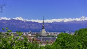 Turin, Torino, aerial timelapse skyline panorama with Mole Antonelliana, Monte dei Cappuccini and the Alps in the background. Turin Torino aerial timelapse stock photo