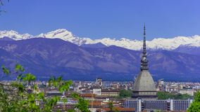 Turin, Torino, aerial timelapse skyline panorama with Mole Antonelliana, Monte dei Cappuccini and the Alps in the background. Turin Torino aerial timelapse royalty free stock photo