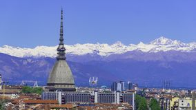 Turin, Torino, aerial timelapse skyline panorama with Mole Antonelliana, Monte dei Cappuccini and the Alps in the background. Turin Torino aerial timelapse stock image