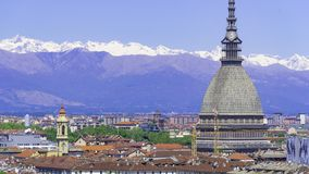 Turin, Torino, aerial timelapse skyline panorama with Mole Antonelliana, Monte dei Cappuccini and the Alps in the background. Turin Torino aerial timelapse stock photography