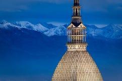 Turin (Torino), Mole Antonelliana and Alps. At blue hour Royalty Free Stock Photos