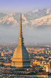Turin (Torino), Mole Antonelliana and Alps. Golden hour Stock Photo