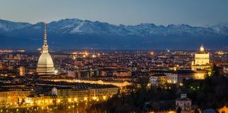Turin (Torino), night panorama. With Mole Antonelliana and Alps Stock Image