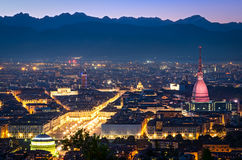 Turin (Torino), panorama at night. With Mole Antonelliana and Alps Royalty Free Stock Photo