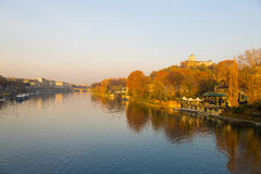 Turin (Torino), Po River, church on hill and colorful trees. City view of Torino (Turin - Italy) at sunset in autumn season with church on hilltop overlooking Po Royalty Free Stock Photo
