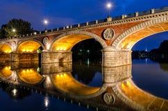 Turin (Torino) Ponte Isabella och flod Po på den blåa timmen Fotografering för Bildbyråer