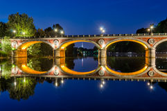 Turin Torino Ponte Isabella and river Po at blue hour. With Mole Antonelliana in the background Stock Image
