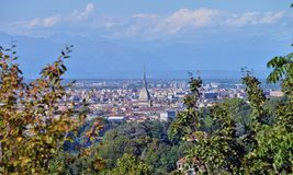 Turin, view from the hill. View of Turin and the southern suburbs with the background of the mountains Royalty Free Stock Photos