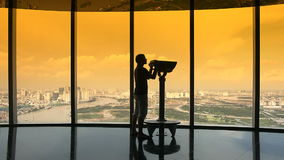 Turis looking through binoculars on observation deck in tower Ho Chi Minh city stock video footage