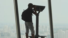 Turis looking through binoculars on observation deck in tower Ho Chi Minh city 3 stock video