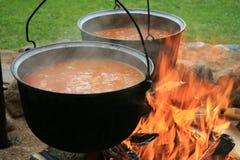 Turismo, un crisol de la sopa en el fuego Imagen de archivo libre de regalías