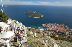 Turist at Dubrovnik cable car station. Cable car station, Dubrovnik, Croatia - 22/5/2015: Turists sitting at the restaurant enjoy the view of the city and the Royalty Free Stock Photo